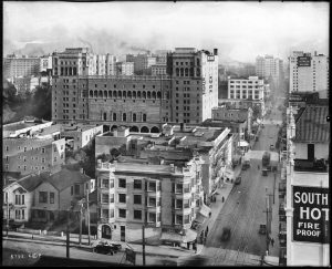 A black and white photograph of the LA skyline in the early 1960s featuring the haunted Knickerbocker hotel said to be haunted by the spirit of D.W.Griffith.